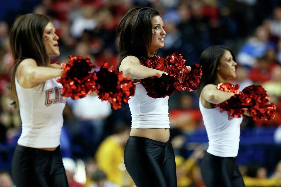 Cheerleaders for the Louisville Cardinals perform during the second round. Photo: Kevin C. Cox, Getty Images / 2013 Getty Images