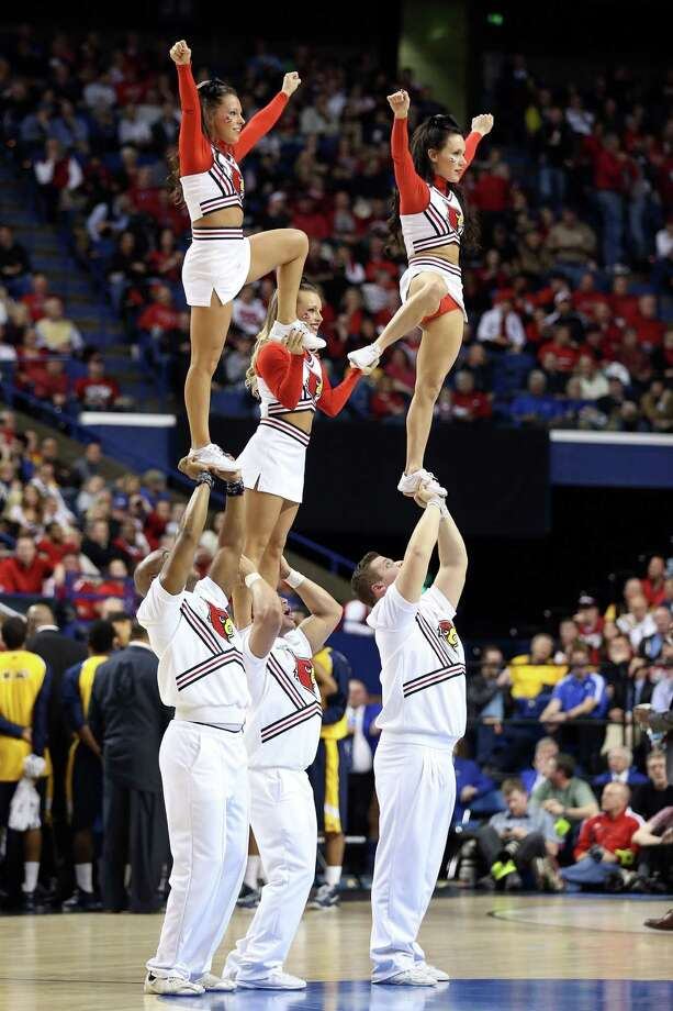 Cheerleaders for the Louisville Cardinals perform during the second round. Photo: Andy Lyons, Getty Images / 2013 Getty Images