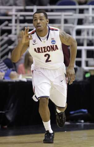 Arizona 81, Belmont 64Arizona's Mark Lyons (2) runs up court after hitting a 3 -pointer in the first half of a second-round game in the NCAA college basketball tournament against Belmont in Salt Lake City Thursday, March 21, 2013. (AP Photo/Rick Bowmer) Photo: Rick Bowmer, Associated Press / AP