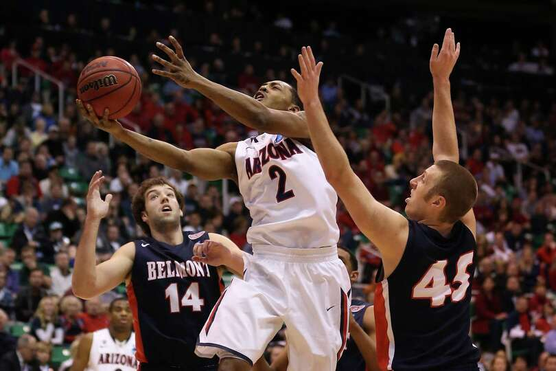 Mark Lyons #2 of the Arizona Wildcats shoots the ball against Brandon Baker #45 of the Belmont Bru