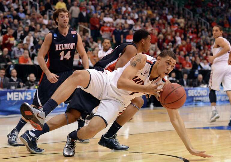 Brandon Ashley #21 of the Arizona Wildcats grabs a rebound in the first half against the Belmont Bru