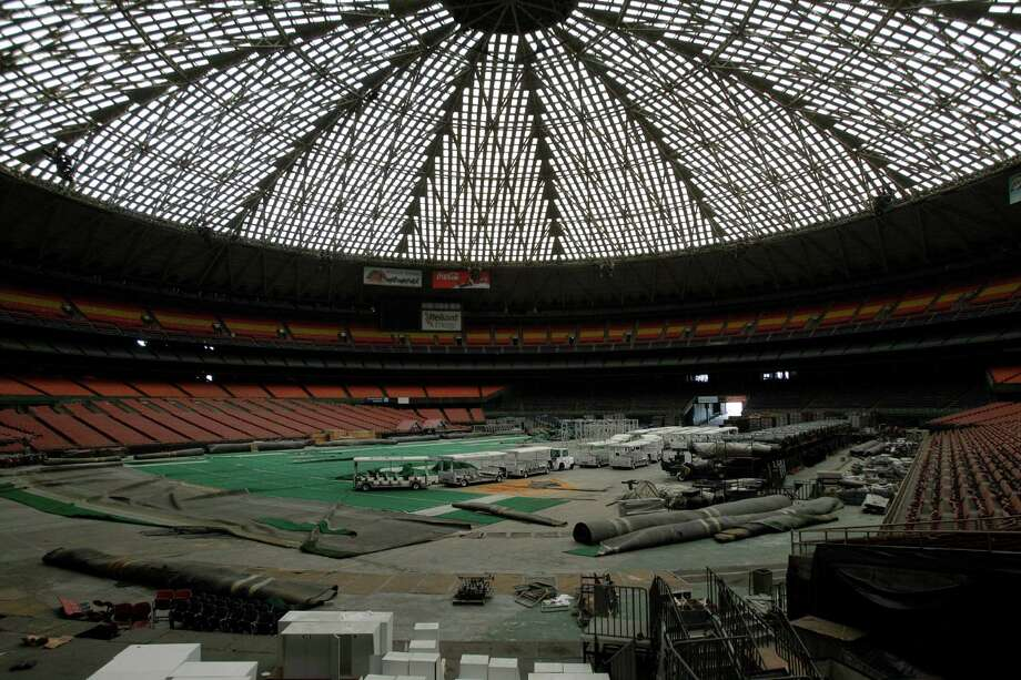 Today, the Astrodome is used mostly as a storage facility, with trams parked among pieces of AstroTurf. Photo: Melissa Phillip, Staff / © 2013  Houston Chronicle