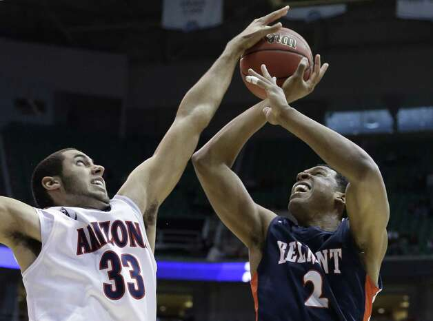 Arizona's Grant Jerrett (33) blocks a shot by Belmont's Blake Jenkins (2) during the first half in a second-round game in the NCAA college basketball tournament in Salt Lake City Thursday, March 21, 2013. (AP Photo/Rick Bowmer) Photo: Rick Bowmer, Associated Press / AP