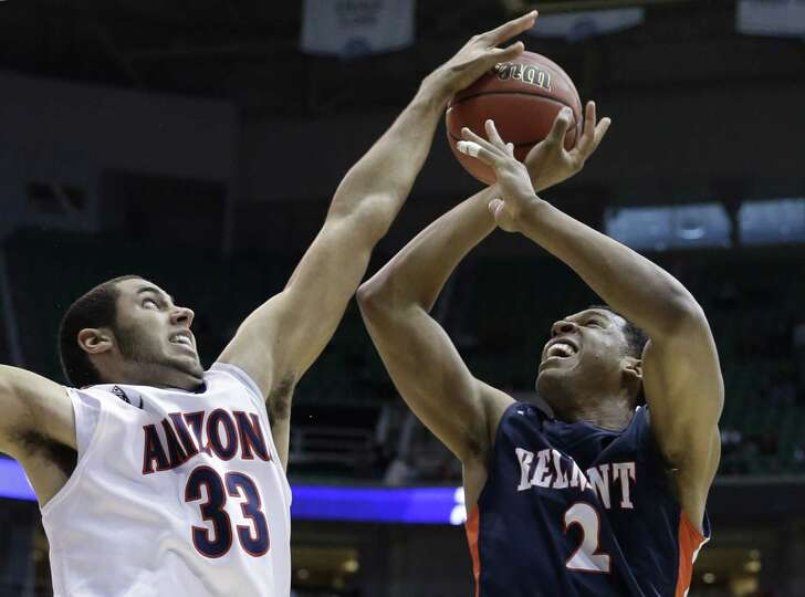Arizona's Grant Jerrett (33) blocks a shot by Belmont's Blake Jenkins (2) during the first half in a