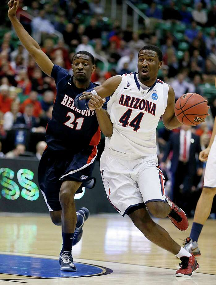 Arizona's Solomon Hill (44) drives to the basket as Belmont's Ian Clark defends in the first half during a second-round game in the NCAA college basketball tournament in Salt Lake City, Thursday, March 21, 2013. (AP Photo/George Frey) Photo: GEORGE FREY PHOTO, Associated Press / FR10102 AP