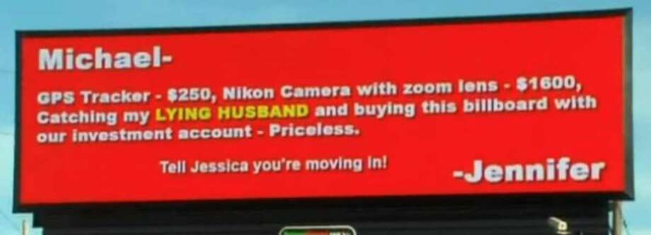 Screen shot from WGHP's news report via ThaBlaze.com. The sign says     Michael,     GPS Tracker ? $250, Nikon Camera with zoom lens ? $1600, Catching my lying husband and buying this billboard with our investment account, ? Priceless.      Tell Jessica you're moving in!      ? Jennifer