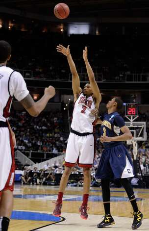 Khem Birch #2 of the UNLV Rebels shoots against Tyrone Wallace #3 of the California Golden Bears in the second half during the second round. Photo: Thearon W. Henderson, Getty Images / 2013 Getty Images