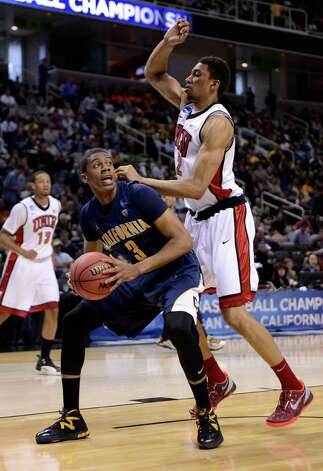 Tyrone Wallace #3 of the California Golden Bears drives to the basket against Khem Birch #2 of the UNLV Rebels in the first half. Photo: Thearon W. Henderson, Getty Images / 2013 Getty Images