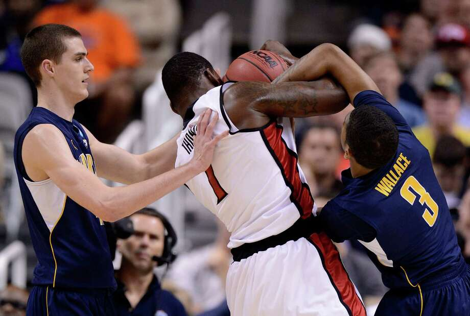 Quintrell Thomas #1 of the UNLV Rebels fights for the ball with David Kravish #45 and Tyrone Wallace #3 of the California Golden Bears in the first half. Photo: Thearon W. Henderson, Getty Images / 2013 Getty Images