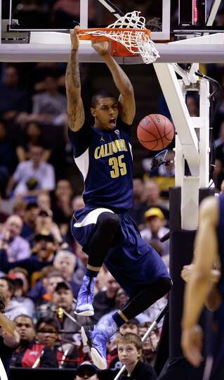 Richard Solomon #35 of the California Golden Bears dunks the ball against UNLV Rebels in the first h