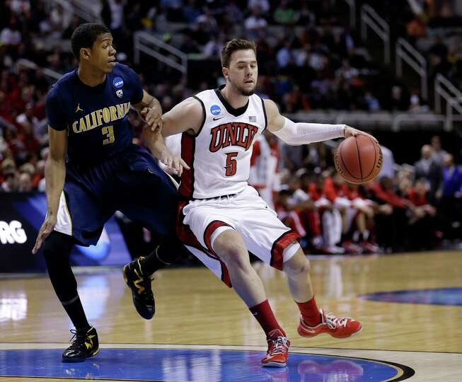 Katin Reinhardt #5 of the UNLV Rebels handles the ball against Tyrone Wallace #3 of the California G