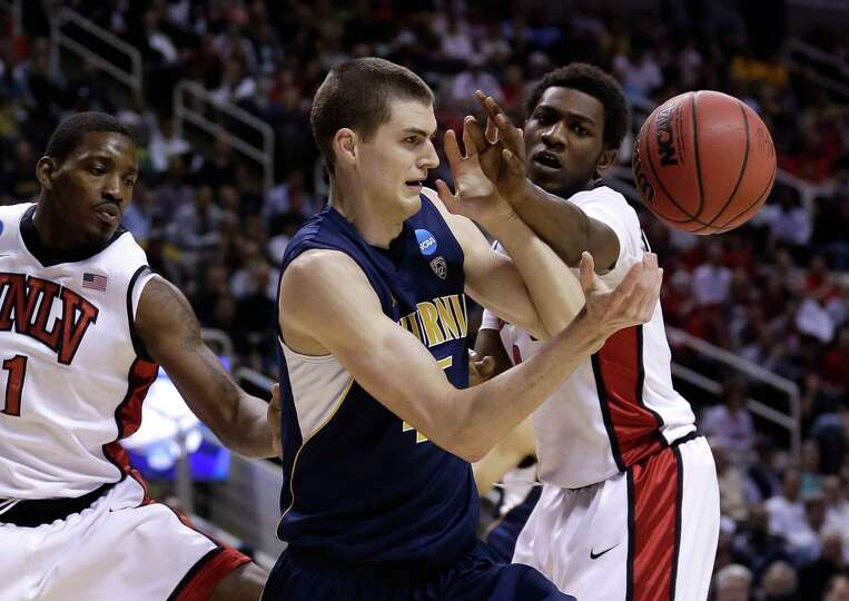David Kravish #45 of the California Golden Bears and Savon Goodman #0 of the UNLV Rebels reach for a