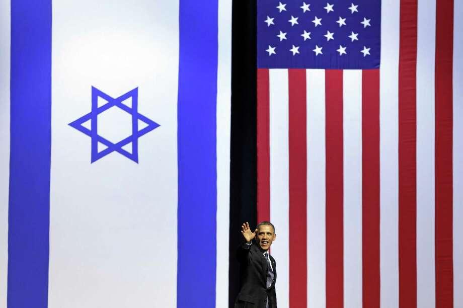 President Barack Obama leaves the stage of the International Convention Center in Jerusalem. Photo: Carolyn Kaster / Associated Press
