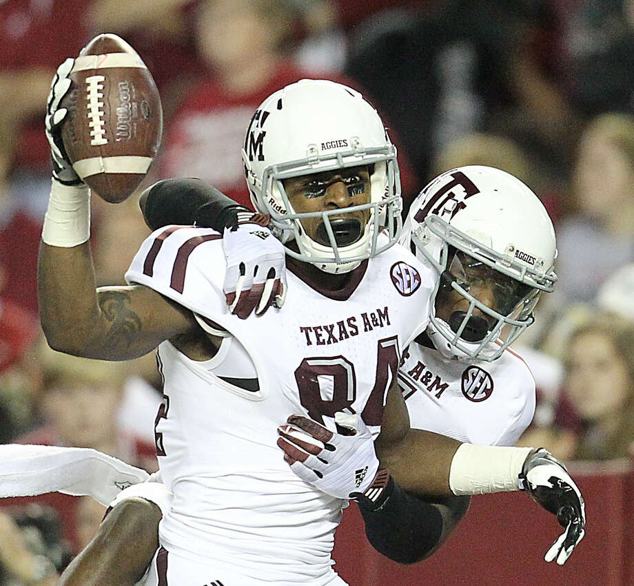 Aggies' receiver Malcome Kennedy (left) celebrates with Uzoma Nwachukwu after catching the decisive TD pass in A&M's upset of Alabama in November. Photo: Karen Warren / Houston Chronicle