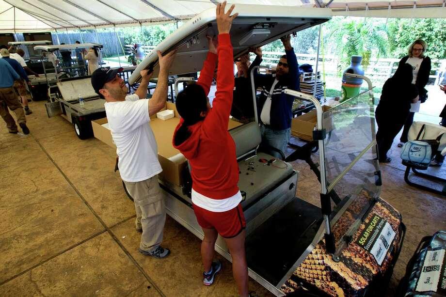 Volunteer Jeremiah Felan, left, Brenda Clark, center, and Kalyan Kareti. Photo: Cody Duty, Houston Chronicle / © 2013 Houston Chronicle