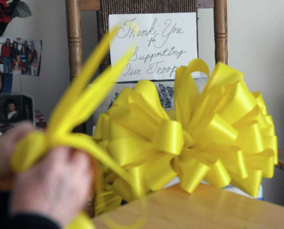 Carol Hotaling of Clifton Park makes yellow ribbons at her home on Thursday, March 21, 2013.  Hotaling started the New York State Yellow Ribbon Day seven years ago after meeting with the parents of soldier Keith (Matt) Maupin who was captured in Iraq on April 9, 2004.  Maupin's remains were found on March 21, 2008.  Hotaling makes ribbons that she sends to Maupin's father who places the ribbons on crosses for an event he holds yearly in Ohio.  This year the New York State Yellow Ribbon event will be held on Friday, April 12th at the Saratoga-Wilton Elks Lodge #161.   (Paul Buckowski / Times Union) Photo: Paul Buckowski
