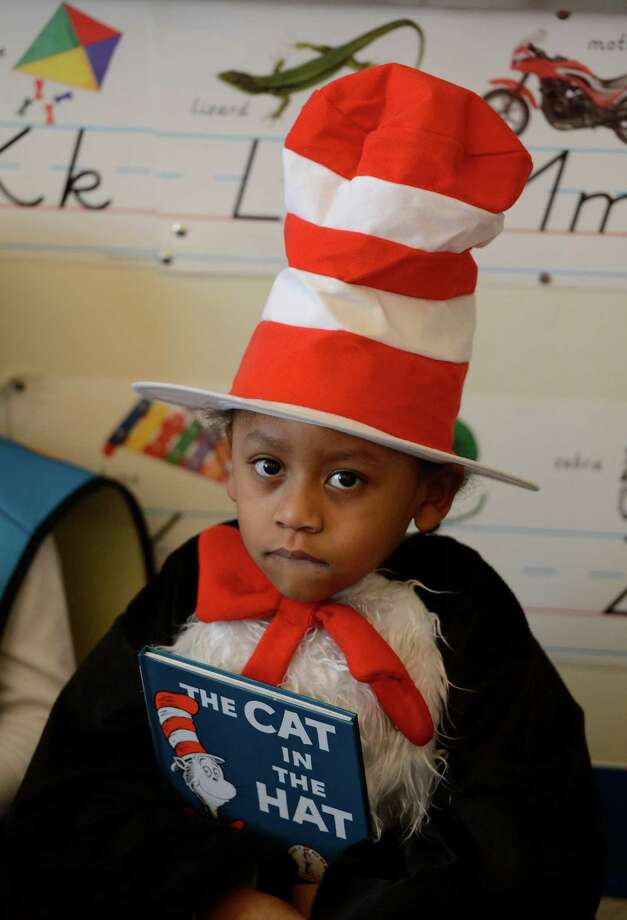 "Cesar Burciaga wears his ""Cat in the Hat"" outfit March 21, 2013, during ""living Literature Day"" as part of the week-long literacy celebration at the Delaware Community School in Albany, N.Y.(Skip Dickstein/Times Union) Photo: SKIP DICKSTEIN / 10021651A"