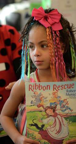 "Janelis Peralta-Rodriguez wears her ""Ribbon Rescue"" costume March 21, 2013, during ""living Literature Day"" as part of the week-long literacy celebration at the Delaware Community School in Albany, N.Y.(Skip Dickstein/Times Union) Photo: SKIP DICKSTEIN / 10021651A"