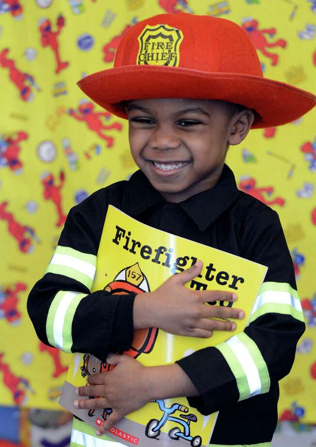 "Aaron Johnson wears his ""Firefighter"" costume March 21, 2013, during ""living Literature Day"" as part of the week-long literacy celebration at the Delaware Community School in Albany, N.Y.(Skip Dickstein/Times Union) Photo: SKIP DICKSTEIN / 10021651A"