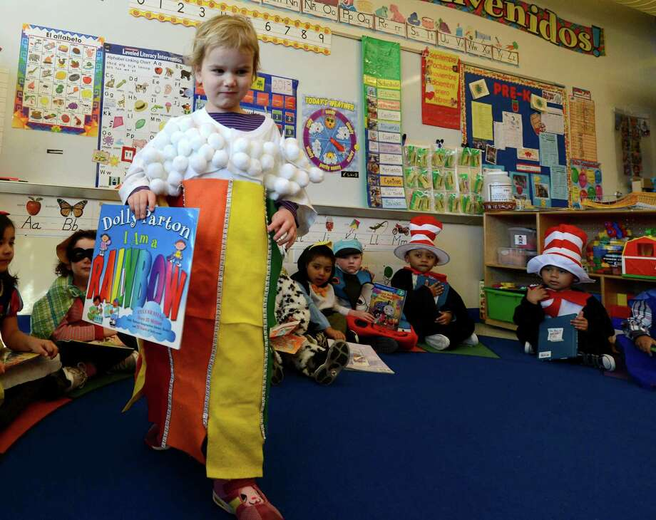 "Elsa Lamont is resplendent in her homemade ""Rainbow"" outfit March 21, 2013, during ""living Literature Day"" as part of the week-long literacy celebration at the Delaware Community School in Albany, N.Y.(Skip Dickstein/Times Union) Photo: SKIP DICKSTEIN / 10021651A"