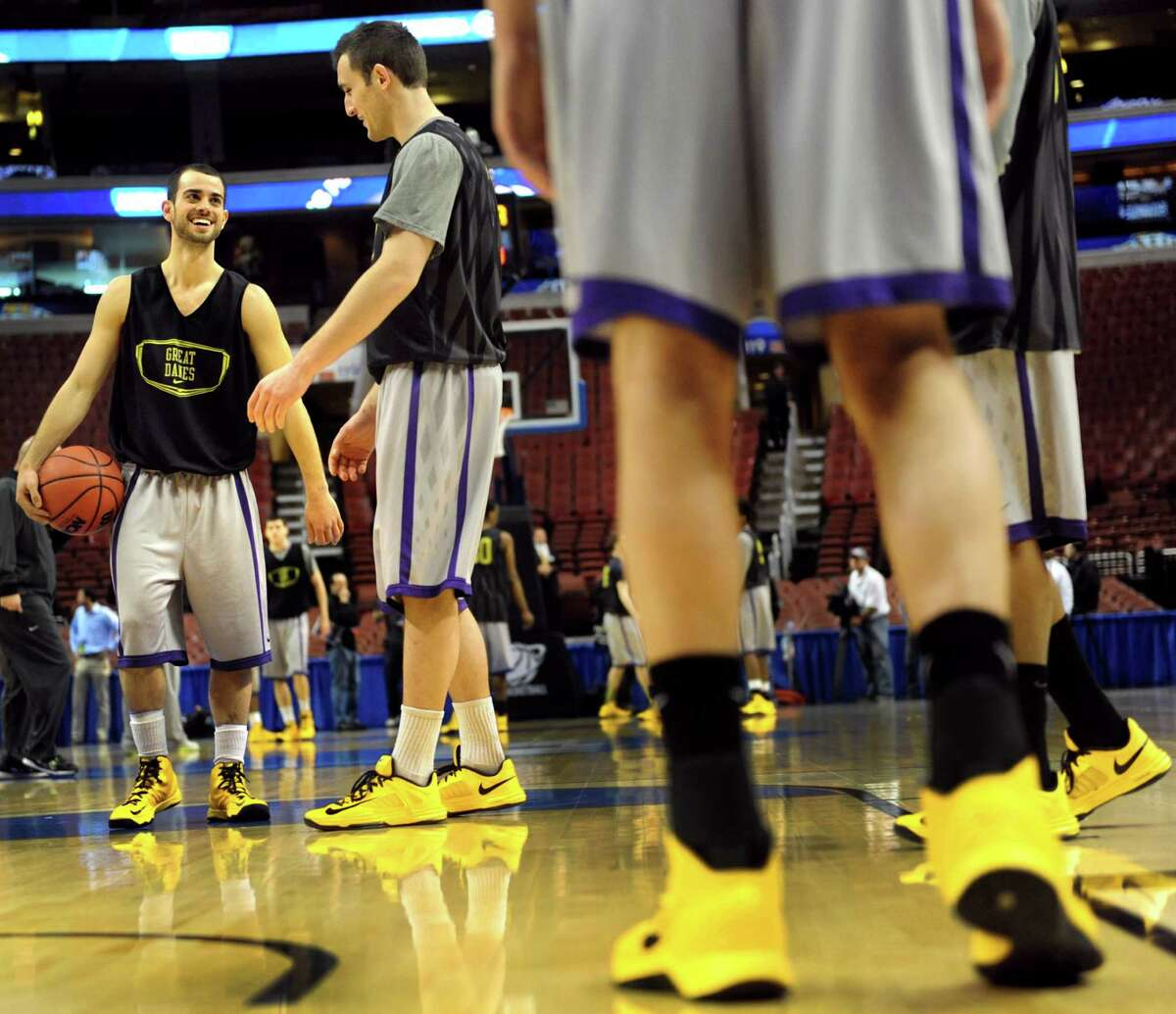UAlbany's Jacob Iati, left, and Sam Rowley, center, enjoy the moment as they get court time during the NCAA Tournament open practice on Thursday, March 21, 2013, at Wells Fargo Center in Philadelphia, Penn. UAlbany plays Duke in the second round on Friday at 12:15 p.m. (Cindy Schultz / Times Union)