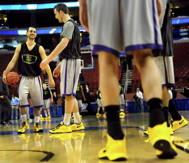 UAlbany's Jacob Iati, left, and Sam Rowley, center, enjoy the moment as they get court time during t