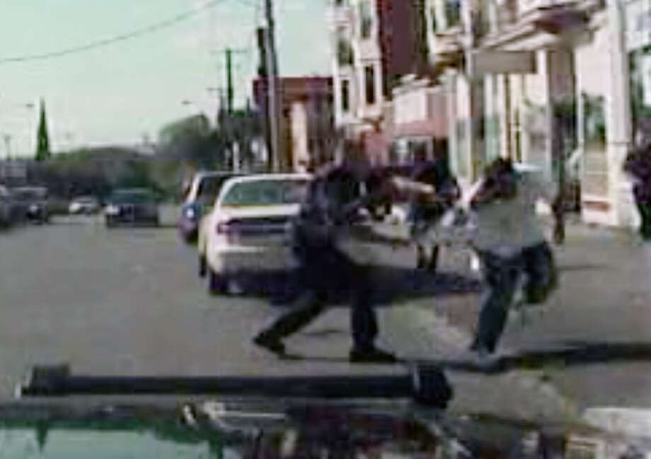 Screen grab from in-car police video which shows Luis Rivera being apprehended by a Schenectady police officer on Aug. 12, 2011.  Rivera was fatally shot. The shooting was the subject of an internal affairs and grand jury investigation that cleared cops of wrongdoing. (Schenectady police)