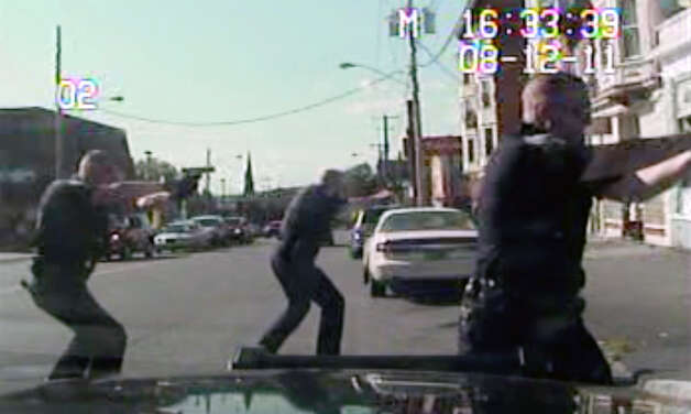 Screen grab from in-car police video which shows Schenectady police officers gunning down Luis Rivera on Aug. 12, 2011.  Rivera was fatally shot. The shooting was the subject of an internal affairs and grand jury investigation that cleared cops of wrongdoing. (Schenectady police)