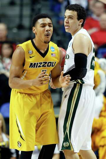 Phil Pressey #1 of the Missouri Tigers reacts after getting called for a foul against Dorian Green #