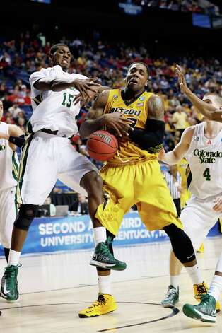 Alex Oriakhi #42 of the Missouri Tigers fights for the loose ball against Gerson Santo #15 of the Colorado State Rams during the second round. Photo: Kevin C. Cox, Getty Images / 2013 Getty Images