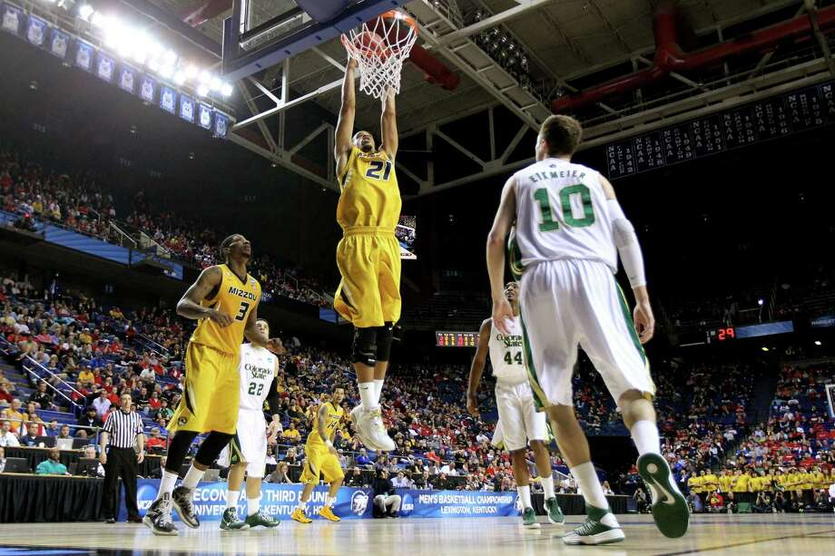 Laurence Bowers #21 of the Missouri Tigers dunks the ball against Wes Eikmeier #10 of the Colorado State Rams during the second round. Photo: Andy Lyons, Getty Images / 2013 Getty Images