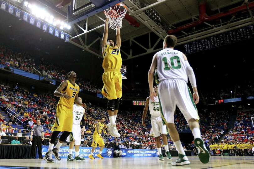 Laurence Bowers #21 of the Missouri Tigers dunks the ball against Wes Eikmeier #10 of the Colorado