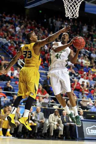 Colorado State 84, Missouri 72LEXINGTON, KY - MARCH 21:  Greg Smith #44 of the Colorado State Rams goes to the hoop against Earnest Ross #33 of the Missouri Tigers during the second round of the 2013 NCAA Men's Basketball Tournament at the Rupp Arena on March 21, 2013 in Lexington, Kentucky. Photo: Andy Lyons, Getty Images / 2013 Getty Images