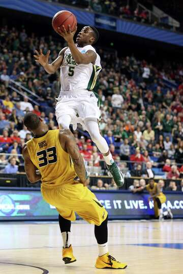 Jon Octeus #5 of the Colorado State Rams goes to the hoops against Earnest Ross #33 of the Missouri