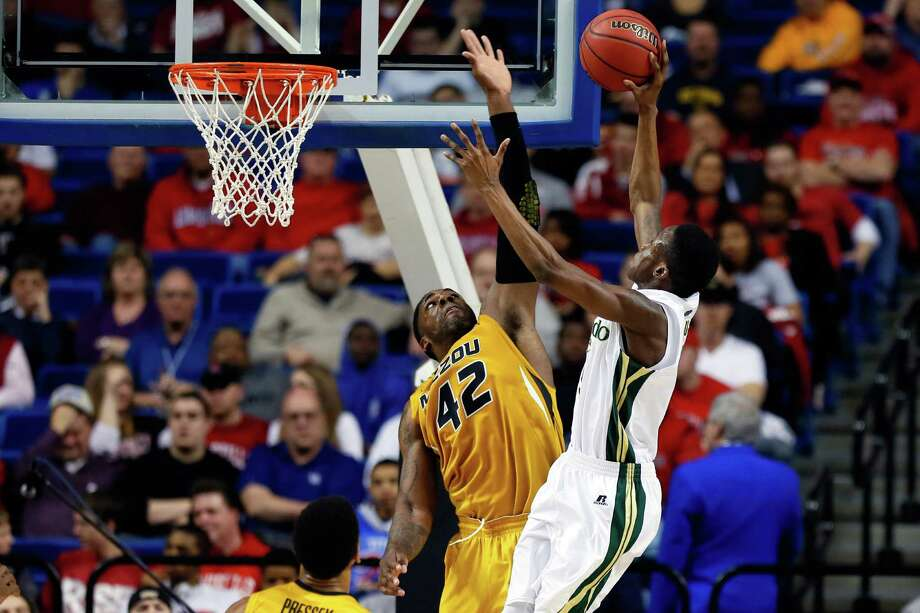 Alex Oriakhi #42 of the Missouri Tigers blocks the shot of Jon Octeus #5 of the Colorado State Rams during the second round. Photo: Kevin C. Cox, Getty Images / 2013 Getty Images
