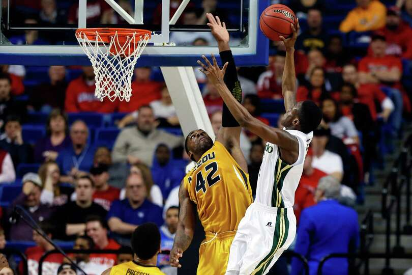 Alex Oriakhi #42 of the Missouri Tigers blocks the shot of Jon Octeus #5 of the Colorado State Rams