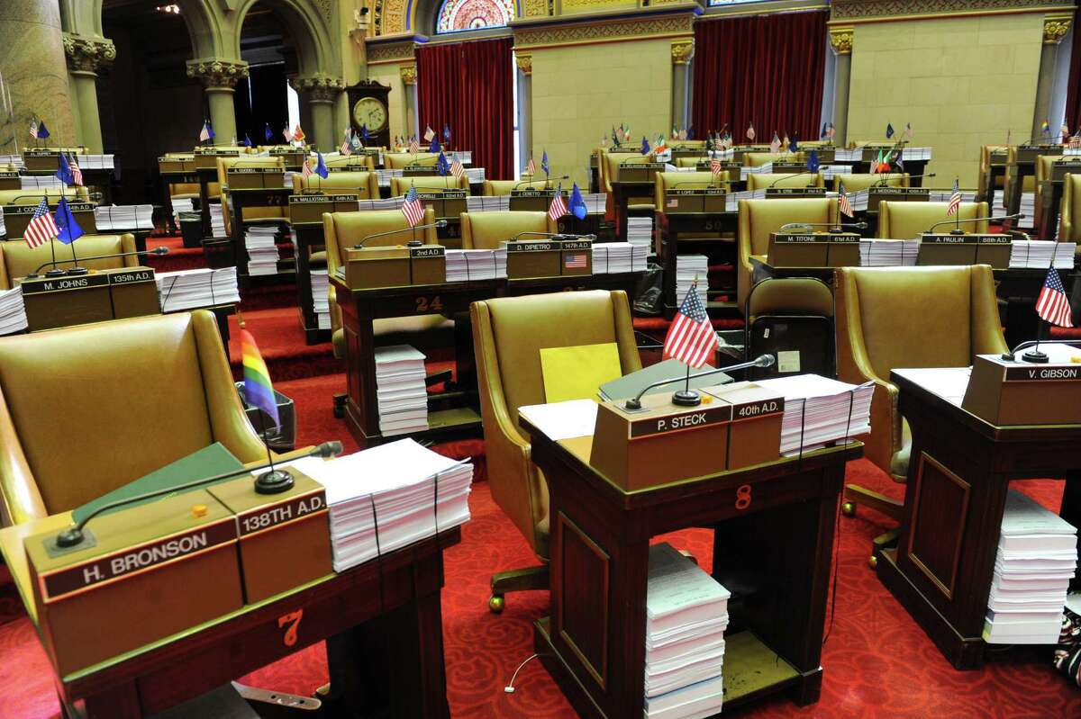 Seats were empty in the assembly chamber on on Thursday afternoon, March 21, 2013 in Albany, N.Y. New Yorkers are hoping for an on-time budget. (Lori Van Buren / Times Union)