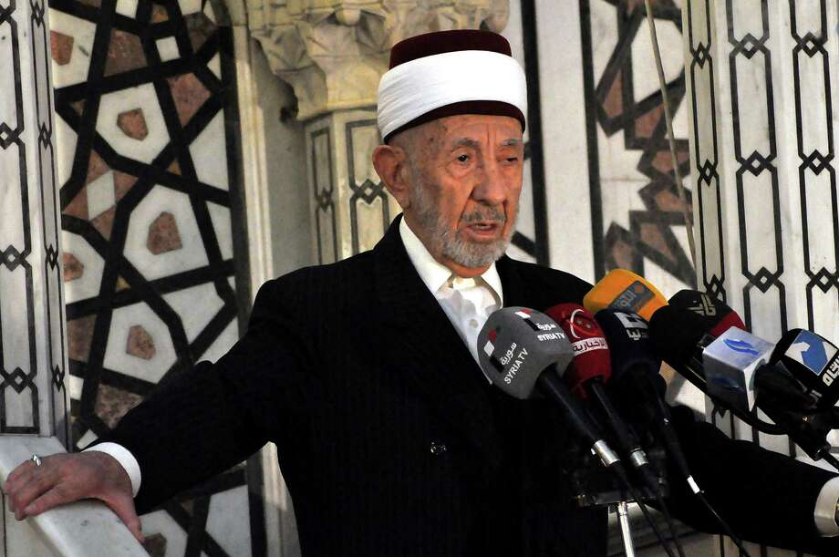 In this undated photo released by the Syrian official news agency SANA, Sheikh Mohammad Said Ramadan al-Buti, an 84-year-old cleric known to all Syrians as a religious scholar, speaks at a press conference. Al-Buti, a top Sunni Muslim preacher and longtime supporter of President Bashar Assad was killed in a suicide bombing in the Eman Mosque, at the Mazraa district, in Damascus, Syria, Thursday, March 21, 2013, state TV reported  (AP Photo/SANA) Photo: Anonymous