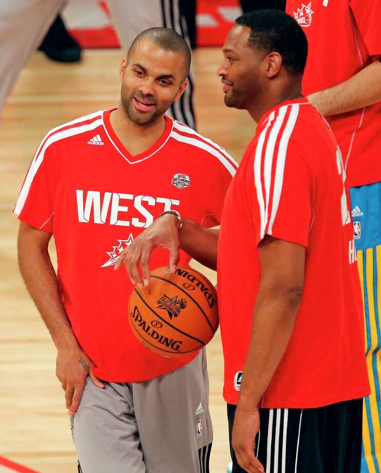 The Spurs' Tony Parker (left) talks with former Spur Robert Horry before the State Farm All-Star Saturday Night at the Toyota Center Saturday Feb. 16, 2013 in Houston. Photo: Edward A. Ornelas, San Antonio Express-News / © 2013 San Antonio Express-News