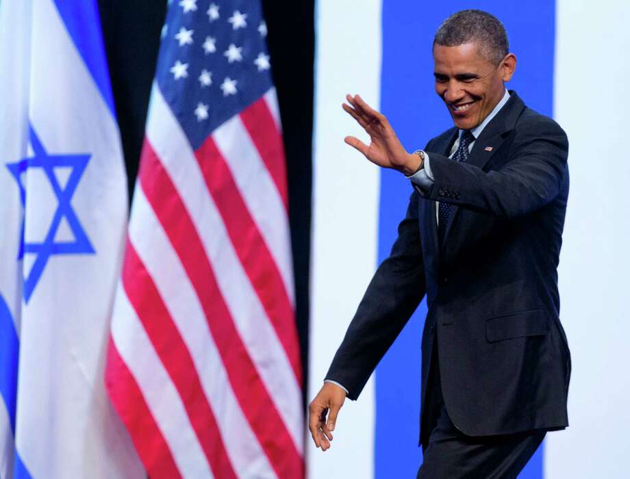 President Barack Obama waves to the audience as he arrives to speak at the International Convention Center in Jerusalem, Thursday, March 21, 2013. (AP Photo/Carolyn Kaster) Photo: Carolyn Kaster