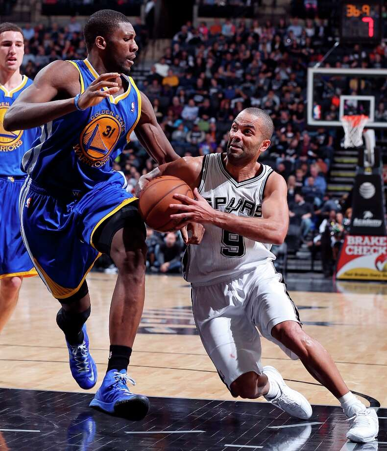 The Spurs' Tony Parker looks for room around Golden State Warriors' Festus Ezeli during first half action Friday, Jan. 18, 2013 at the AT&T Center. Photo: Edward A. Ornelas, San Antonio Express-News / © 2012 San Antonio Express-News