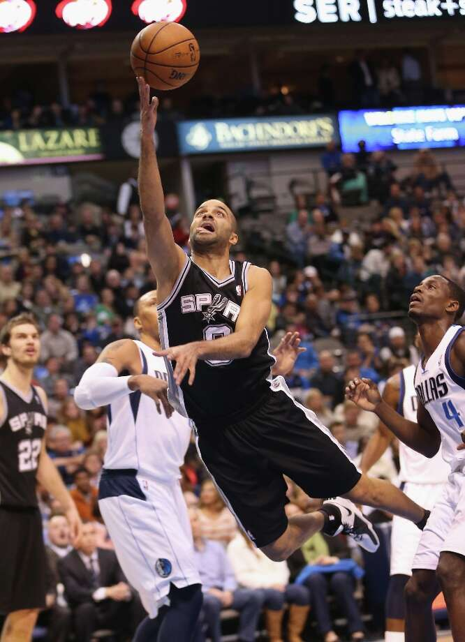 Tony Parker  (9) of the Spurs takes a shot against the Dallas Mavericks at American Airlines Center on Dec. 30, 2012 in Dallas. Photo: Ronald Martinez, Getty Images / 2012 Getty Images