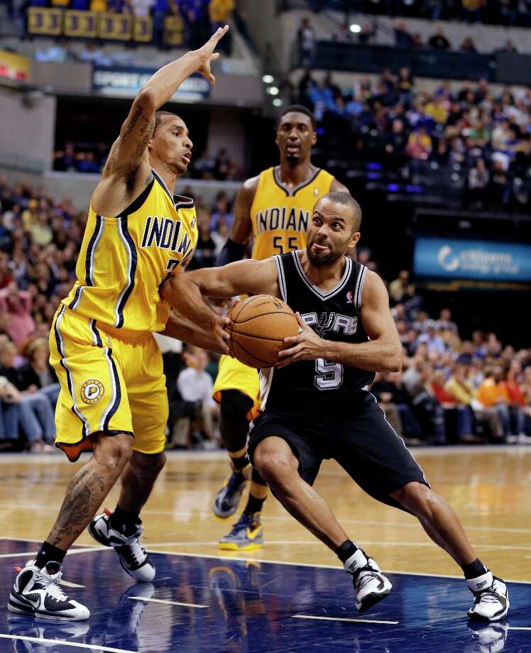 The Spurs' Tony Parker drives to the basket against Indiana Pacers' George Hill during the second half Friday, Nov. 23, 2012, in Indianapolis. The Spurs won 104-97. Photo: Darron Cummings, Associated Press / AP