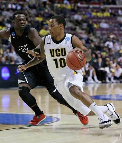 VCU 88, Akron 42Virginia Commonwealth guard Darius Theus (10) drives on Akron forward Demetrius Treadwell (1) during the first half of a second-round game of the NCAA college basketball tournament. Photo: Paul Sancya, Associated Press / AP
