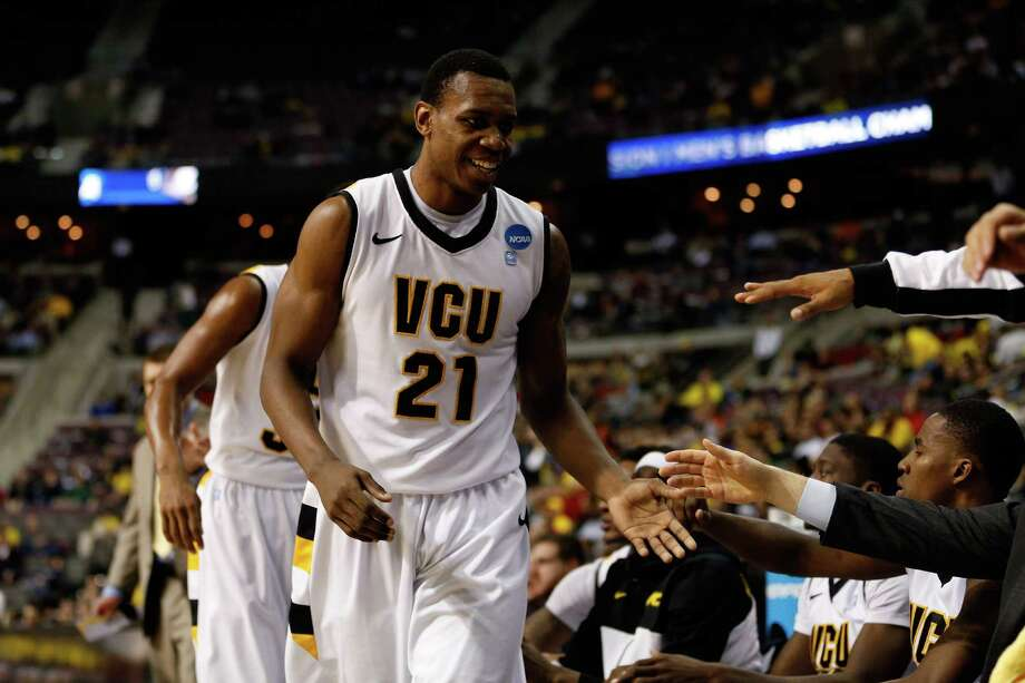 Treveon Graham #21 of the Virginia Commonwealth Rams greets teammates on the bench against the Akron Zips during the second round. Photo: Gregory Shamus, Getty Images / 2013 Getty Images