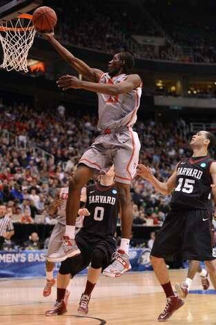 SALT LAKE CITY, UT - MARCH 21:  Tony Snell #21 of the New Mexico Lobos lays the ball up in front of Christian Webster #15 of the Harvard Crimson in the first half during the second round of the 2013 NCAA Men's Basketball Tournament at EnergySolutions Arena on March 21, 2013 in Salt Lake City, Utah. Photo: Harry How, Getty Images / 2013 Getty Images