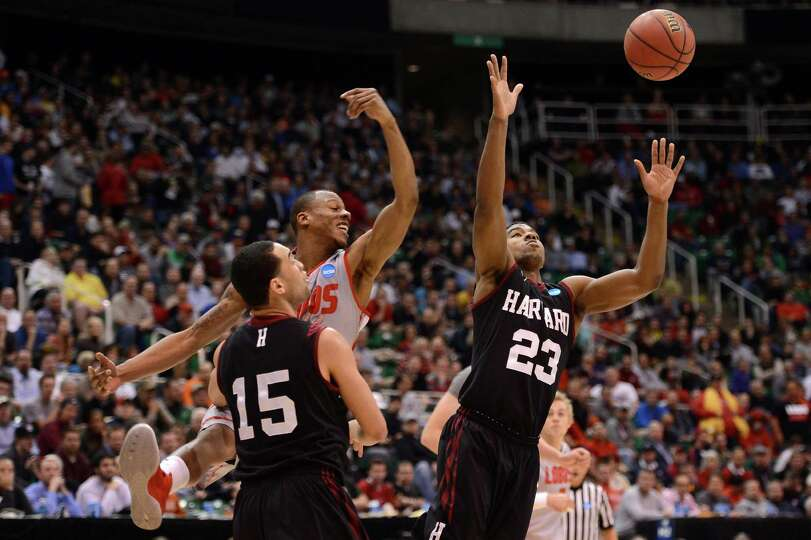 SALT LAKE CITY, UT - MARCH 21:  Wesley Saunders #23 of the Harvard Crimson goes for the loose ball a