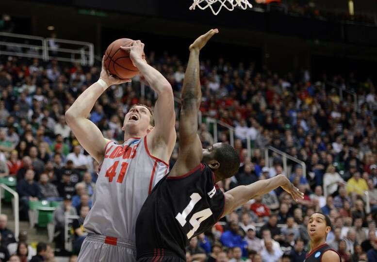 SALT LAKE CITY, UT - MARCH 21:  Cameron Bairstow #41 of the New Mexico Lobos shoots over Steve Mound