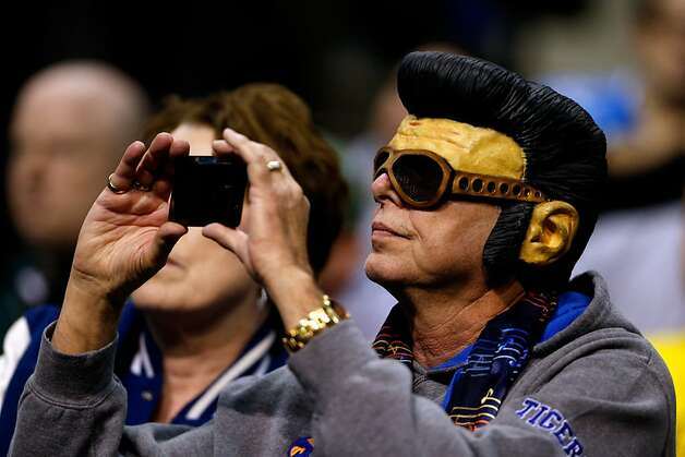 A fan of the Memphis Tigers wears an Elvis mask as he supports Memphis against the St. Mary's Gaels during the second round of the 2013 NCAA Men's Basketball Tournament at at The Palace of Auburn Hills on March 21, 2013 in Auburn Hills, Michigan.  (Photo by Gregory Shamus/Getty Images) Photo: Gregory Shamus, Getty Images
