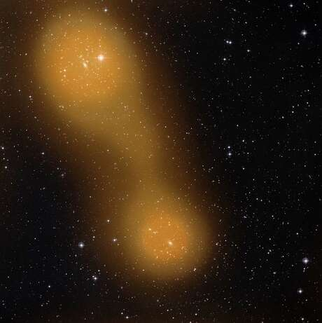 An image from the Planck spacecraft shows a bridge of hot gas that connects galaxy clusters about a billion light-years from Earth. Photo: Associated Press